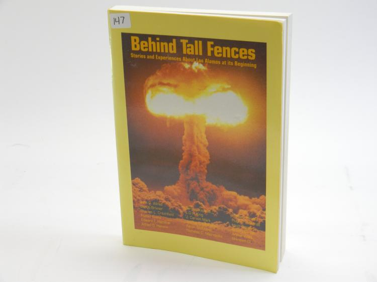 "First Edition ""Behind Tall Fences"" Paperback Book"