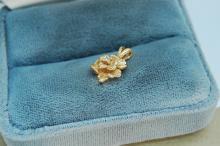 Lot 192: 1.4g 14K Gold Diamond Rose Pendant