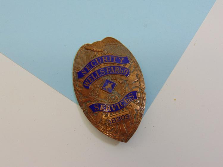 Lot 47: Vintage Wells Fargo Enameled Security Services Badge