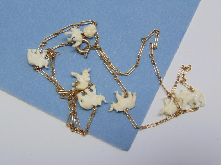 Lot 86: Vintage Gold Filled Carved Ivory Elephant Necklace