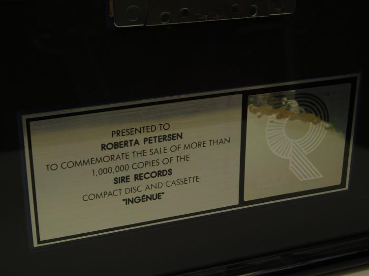 Lot 18: 2 Riaa Certified Sales Platinum Gold Cassette & Cd Kd Lang Sales Awards Presented To Roberta Peterson