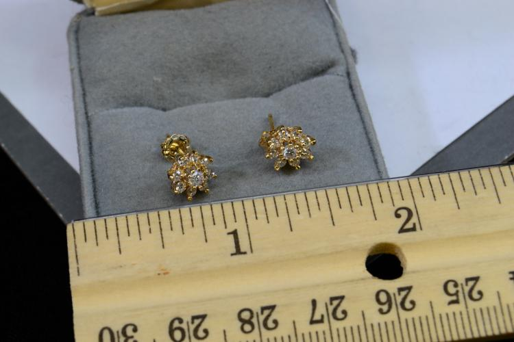Lot 122: 1.2 Gram 14 Karat Yellow Gold And Diamond Post Earrings