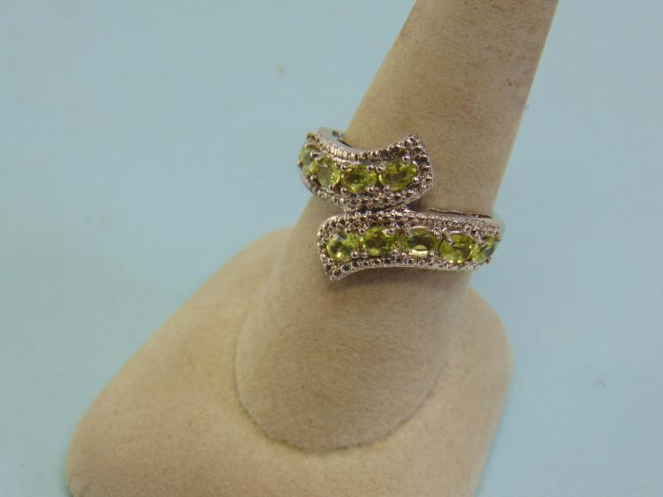 Lot 8: Sterling Over Brass Peridot Ring Size 8