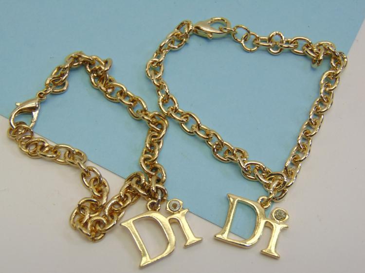 Christian Dior Goldtone Charm Bracelet Lot Of 2