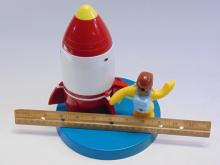 Lot 12: Curious George Rocket Gumball Dispenser Bank