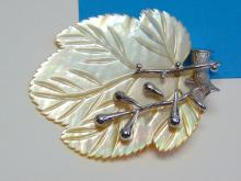 Lot 39: Beautiful Mother of Pearl and Sterling Silver Leaf Pendant