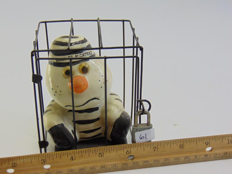 Lot 61: Vintage Souvenir Bank of Alcatraz Ceramic Prisoner in a Cage