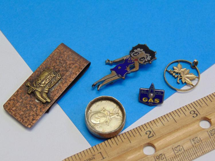 Lot 112: Lot of Smalls Including Betty Boop, a Money Clip, and a Silver Coin