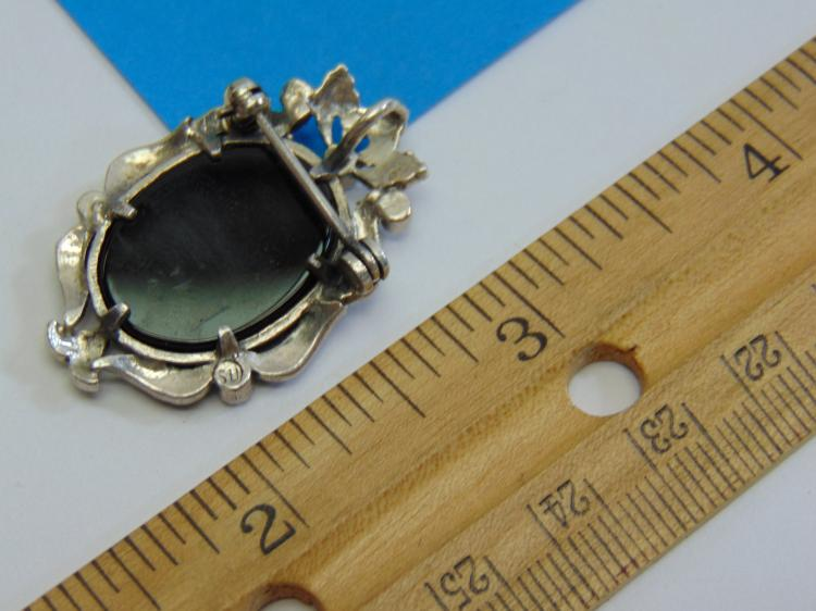 Lot 189: Sterling Silver Marcasite and Mother of Pearl Cameo Brooch or Pendant