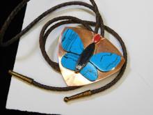 Lot 40: Southwestern Mexico Copper Faux Turquoise Purple Goldstone Butterfly Bolo Tie