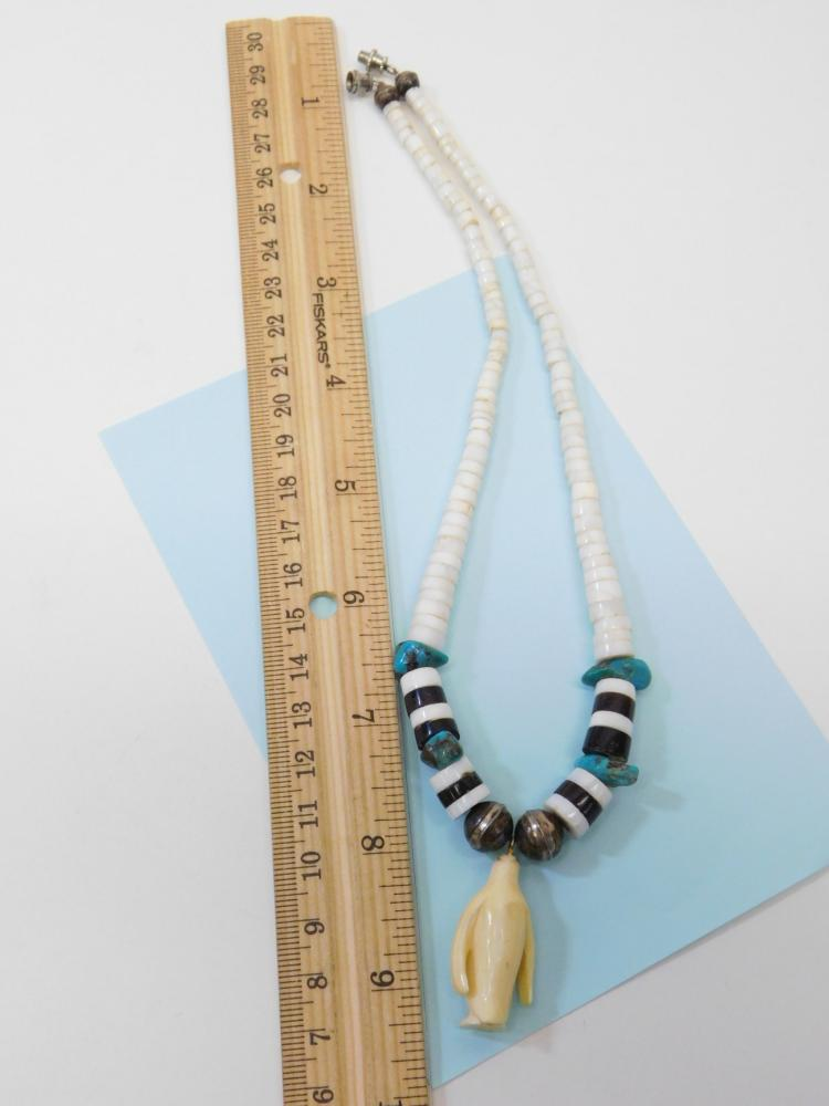 Lot 59: Vintage Navajo Bench Bead Turquoise Shell Beaded Necklace With Carved Ivory Penguin Pendant