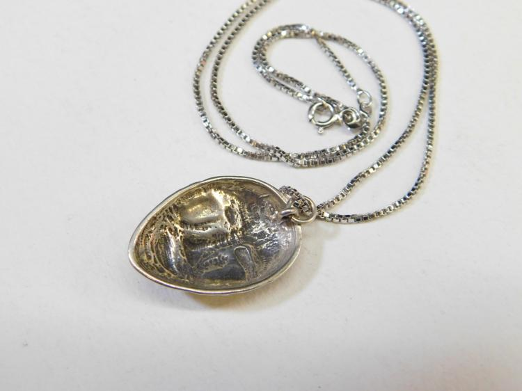 Lot 192: Modern Sterling Silver Tribal Mask Pendant Necklace
