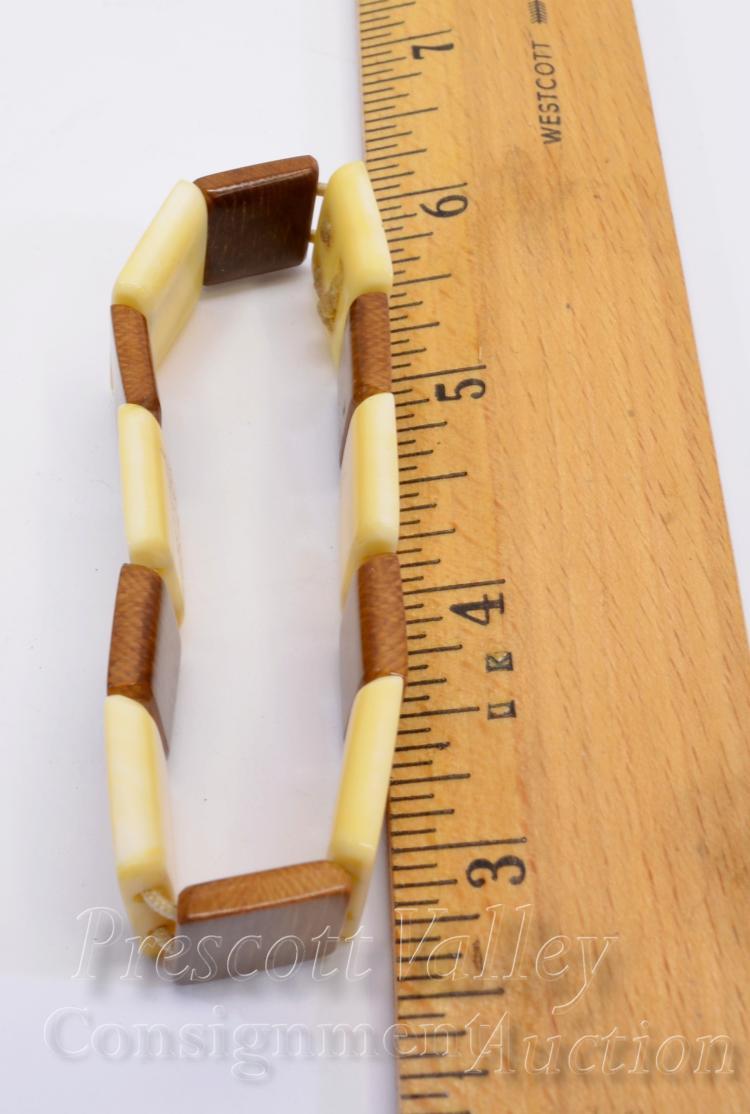 Lot 39: Inuit Scrimshaw Walrus Tusk and Fossilized Mammoth Ivory Storyteller Bracelet Signed Okpowruk Shishmare AK