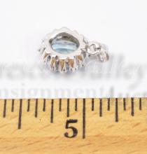 Lot 114: 1.5 Gram 14K White Gold Blue Topaz and Chip Diamond Pendant