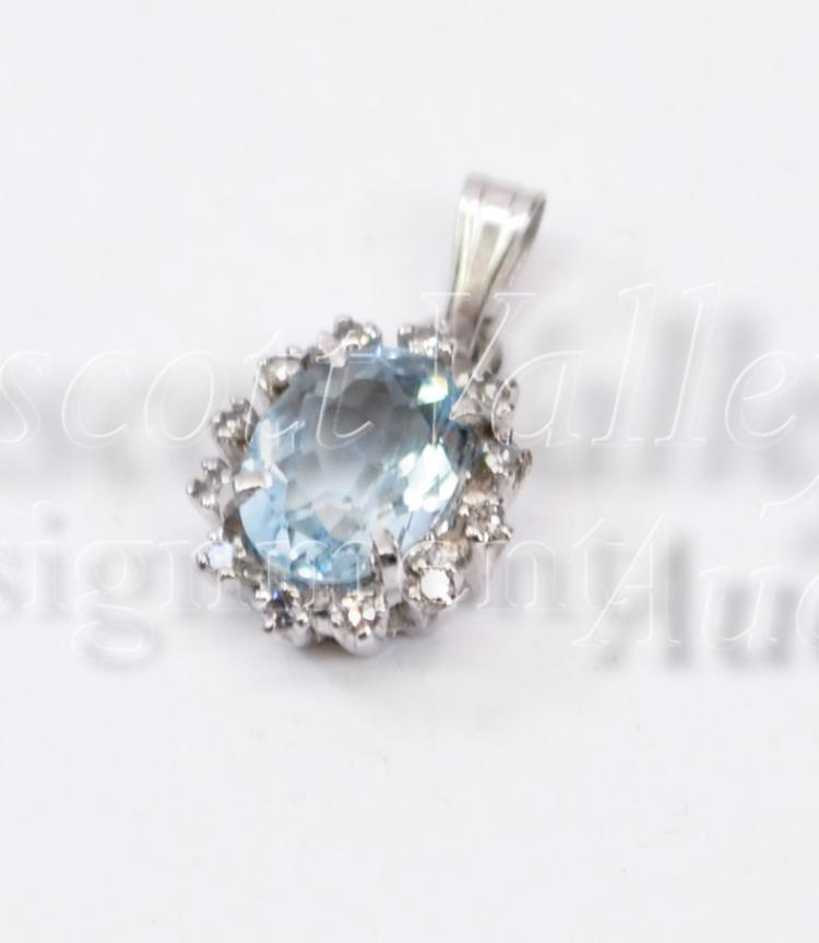 1.5 Gram 14K White Gold Blue Topaz and Chip Diamond Pendant