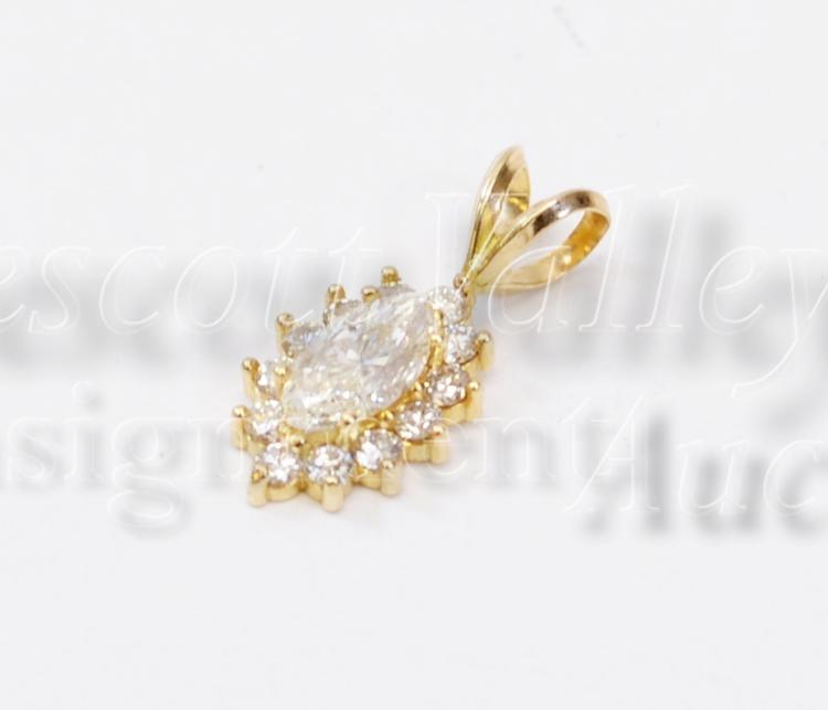 Lot 117: 1.4 Gram 14K Yellow Gold and Diamond Pendant