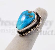 Lot 127: 7.9 Gram Navajo Sterling Silver and Turquoise Ring Sz 4.5