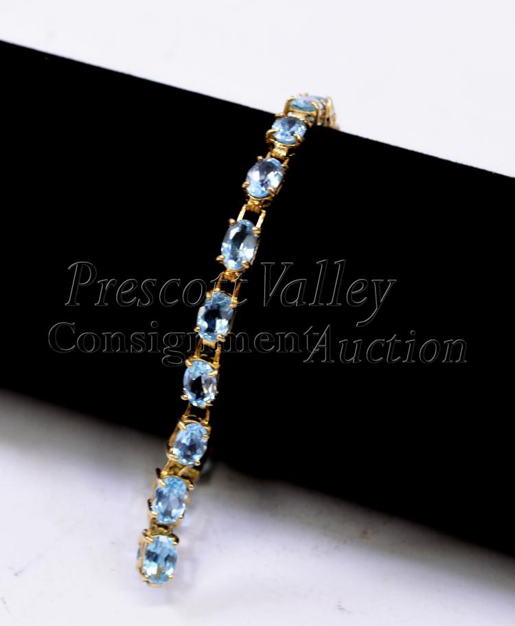 "7.5 Gram 14K Yellow Gold and Blue Topaz 7.25"" Tennis Bracelet Signed CID"