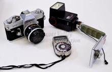 Lot 151: Vintage Canon FT 35mm Film Camera with Cases Grip Flash Film Instructions and Weston Light Meter