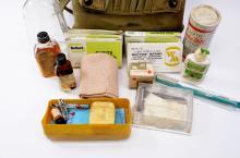 Lot 186: WWII Era US Military Med Kit Pack Full of Supplies Including Snake Bite Kit and Bakelite Case