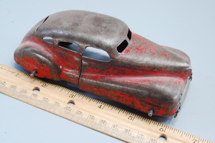 Lot 142: Antique 1/43rd Scale Pressed Steel Toy Car with Wo