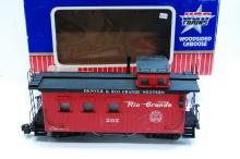 Lot 100V: USA Trains G Scale Red D&RGW Wood Sided Train Caboose