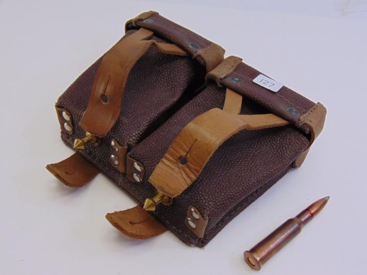 Ammo Cartridge Pouches Full Of Lrg Caliber Bullets