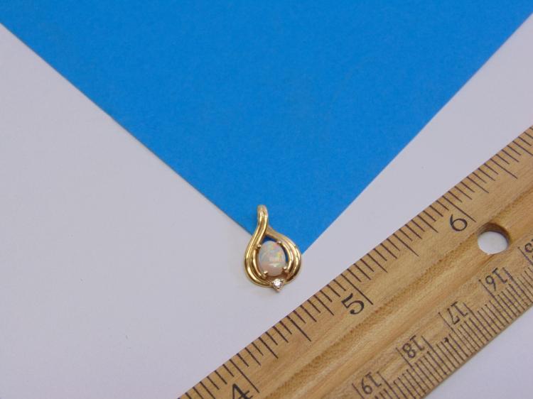 Lot 168: 14K Yellow Gold Diamond & Opal Pendant