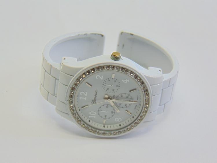 Lot 196: Geneva Platinum No 8495 White Enamel and Rhinestone Women's Cuff Watch