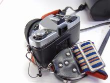 Lot 161: Vintage Minolta XG7 35mm Camera, Papers, Rokkor 50mm, Vivitar 100-200mm, & Sakar 28mm Lenses