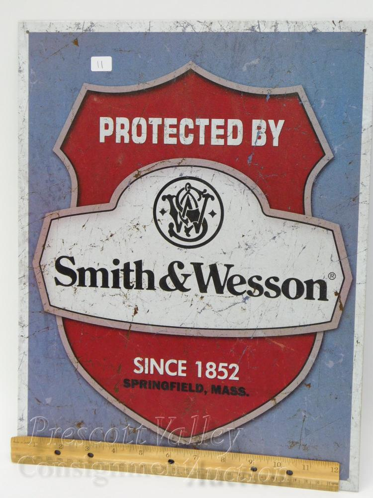 Lot 11: Protected By Smith & Wesson Since 1852 Tin Sign