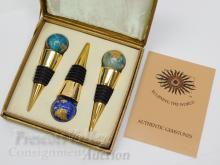 Lot 27: Eclipsing the World Brass Enamel and Inlaid Gemstone Globe Wine Bottle Stopper Set of 3