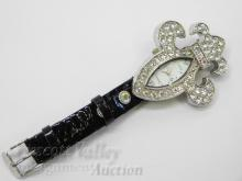 Lot 70: Geneva Platinum Rhinestone Fleur De Lis Lady's Wrist Watch