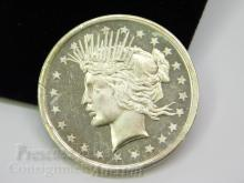 Lot 137: Peace Dollar Style One Troy Ounce .999 Fine Silver Trade Unit Bullion Round