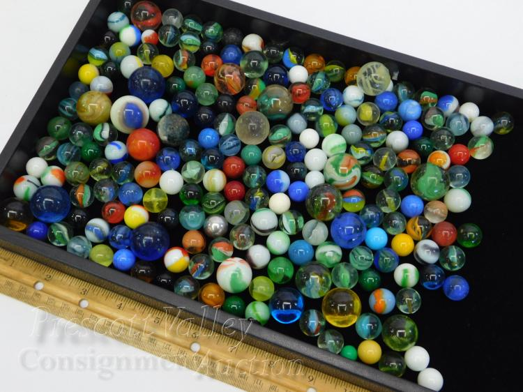 Lot 151: 2.8 Pound Lot of Cat's Eye Aggies Puries Clearies Steelies Shooters and Pewee Marbles
