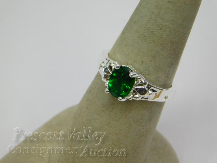 Lot 165: Rhodium Plated and Green CZ Ring Sz 7