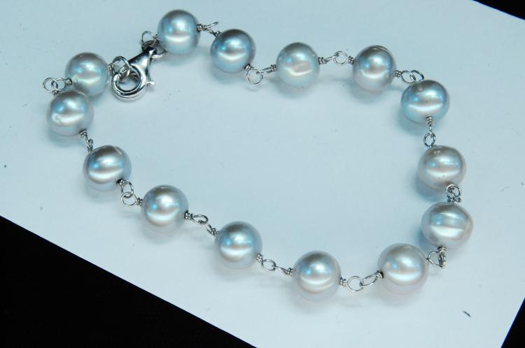 "Lot 58: Sterling ""Silver Pearl"" Ladies Bracelet"