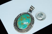 Lot 169: 16g Sterling Turquoise Navajo Signed W Pendant