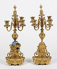 PAIR OF GILT BRONZE CANDELABRA - Four branch candelabra in the Directoire style ornamented with acanthus leaves, floral garlands and...
