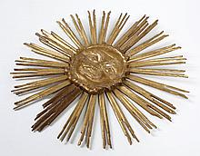 GILDED WOOD PORTRAYAL OF THE SUN GOD - Carved and gilded wood face resembling the Greek sun god Apollo with extending sun rays