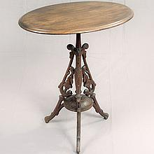 ANTIQUE WALNUT TILT TOP TABLE - Walnut Eastlake style table with oval top, turned central column, relief-carved tripod support with...