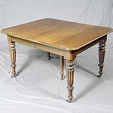 EXTENSION DINING TABLE - Antique mahogany with rounded corner rectangular top, straight skirting, turned legs, brass casters and two...
