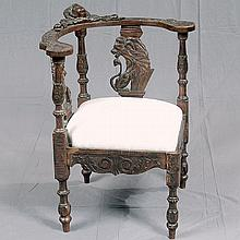 WALNUT CORNER CHAIR - Scottish style corner chair with yoke-style horizontal arm rests, turned and carved upright supports, figural...