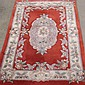 CARPET: HAND-KNOTTED CHINESE FLORAL - Wool on a cotton warp with red field, central floral cartouche with lilac accents, cream-color...