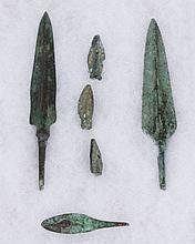 SET OF SIX NEAR EASTERN LATE BRONZE AGE SPEAR AND ARROW POINTS - The two larger points are triangular form with a prominent central ...