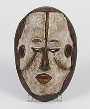NIGERIAN CARVED WOOD IGBO MASK - Painted chalk white this mask represents unspecified spirits of the dead which form a vast communit...