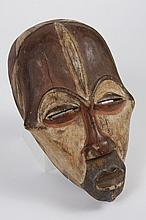 DEMOCRATIC REPUBLIC OF THE CONGO CARVED WOOD KUBA MASK - Decorated with geometric surface designs emphasized with contrasts of color...