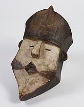 TSOGHO CARVED WOOD MASK - From the Ngounie province of Gabon whose people are known for their ability to conjure spirits from the af...