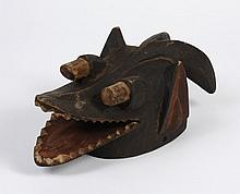 AFRICAN TRIBAL ART; CARVED WOOD MAMBILA MASK - From Cameroon and Nigeria. Helmet mask representing a hybrid animal; a dog with open...