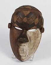 DEMOCRATIC REPUBLIC OF THE CONGO CARVED WOOD SALAMPASU MASK - An integral part of this warrior society, Salampasu tribesmen had to e...